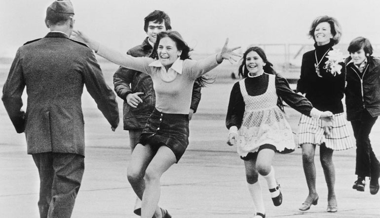 Released POW, Lt. Col. Robert L. Stirm, is greeted by his family. Travis Air Force Base, March 17, 1973.