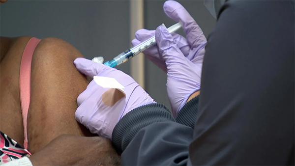 A COVID-19 vaccine is administered. (WTTW News)