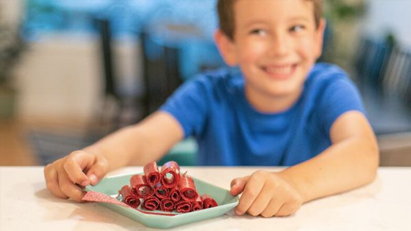 Boy with Fruit Leather